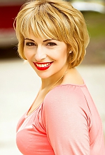 Ukrainian girl Alena,34 years old with green eyes and blonde hair.