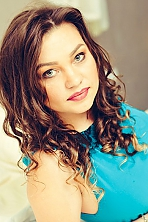 Moldovan girl Rodika,24 years old with grey eyes and light brown hair.
