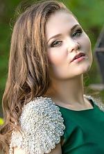Ukrainian girl Viktoriya,19 years old with blue eyes and dark brown hair.