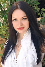 Ukrainian girl Angelina,25 years old with grey eyes and black hair.