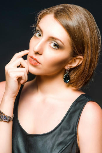 Ukrainian girl Karina,29 years old with green eyes and auburn hair.