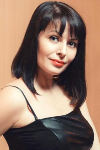 Ukrainian girl Nataliya,42 years old with blue eyes and black hair.