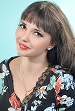 Ukrainian girl Oksana,23 years old with green eyes and dark brown hair.