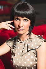 Ukrainian girl Nataliya,45 years old with green eyes and black hair.