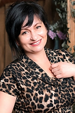 Ukrainian girl Oksana,45 years old with hazel eyes and auburn hair.