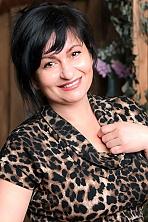Ukrainian girl Oksana,44 years old with hazel eyes and auburn hair.