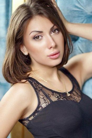 Ukrainian girl Alina,22 years old with grey eyes and black hair.