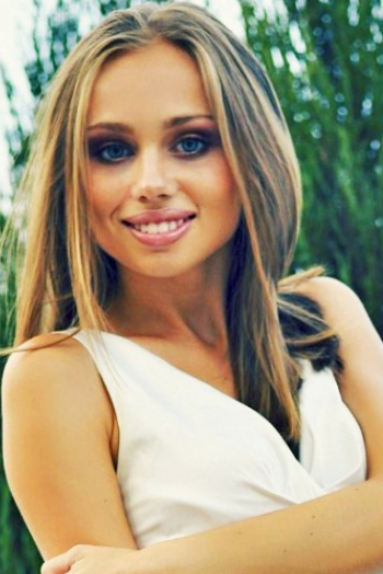 Ukrainian girl Marina,22 years old with grey eyes and light brown hair.