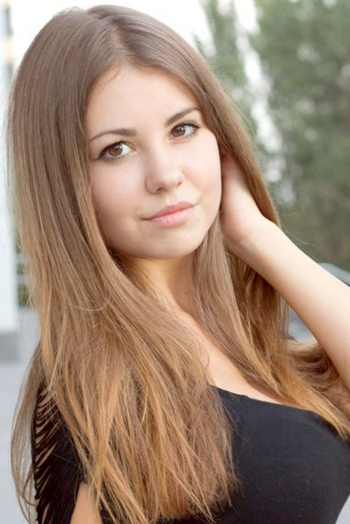 Ukrainian girl Julia,22 years old with brown eyes and light brown hair.