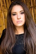 Ukrainian girl Irina,28 years old with brown eyes and dark brown hair.
