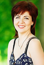 Ukrainian girl Oksana,46 years old with green eyes and dark brown hair.