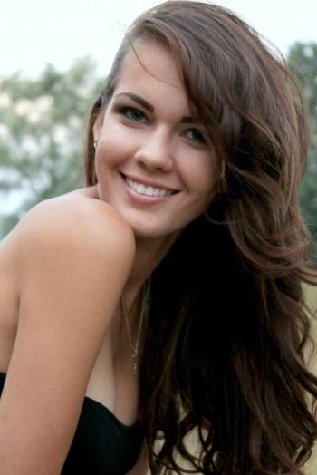 Ukrainian girl Inga,21 years old with green eyes and dark brown hair.