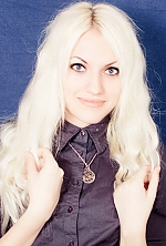Ukrainian girl Ol'ga,21 years old with green eyes and blonde hair.
