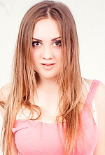 Ukrainian girl Elena,20 years old with brown eyes and blonde hair.