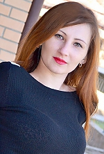 Ukrainian girl Tatyana ,28 years old with green eyes and red hair.
