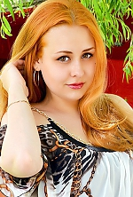 Ukrainian girl Elena,24 years old with brown eyes and red hair.