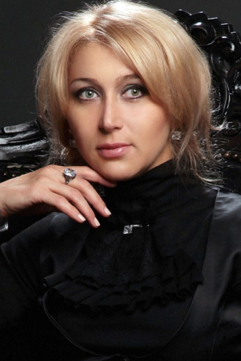 Ukrainian girl Svetlana,42 years old with green eyes and blonde hair.