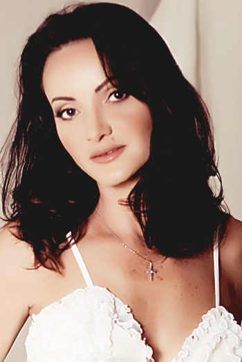 Ukrainian girl Oksana,47 years old with blue eyes and dark brown hair.