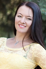 Ukrainian girl Elena,25 years old with green eyes and dark brown hair.