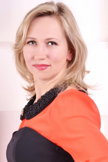 Ukrainian girl Natalia ,43 years old with blue eyes and blonde hair.