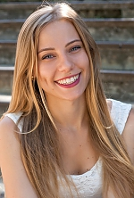 Ukrainian girl Ekaterina,21 years old with grey eyes and light brown hair.