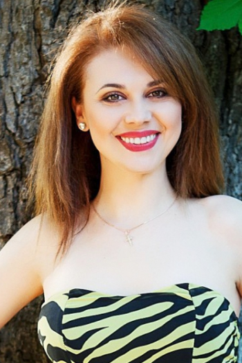 Ukrainian girl Vitalina,36 years old with black eyes and dark brown hair.