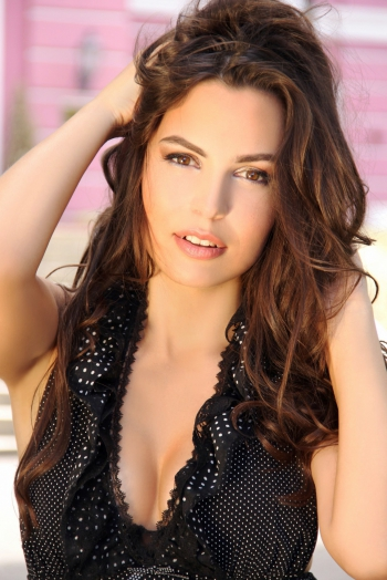 Ukrainian girl Anastasia,26 years old with hazel eyes and light brown hair.