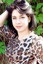 Ukrainian girl Tatiana,37 years old with brown eyes and black hair.