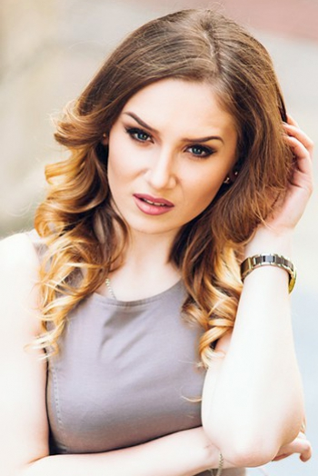 Moldovan girl Alina,20 years old with blue eyes and light brown hair.