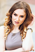 Moldovan girl Alina,21 years old with blue eyes and light brown hair.