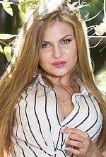 Ukrainian girl Ksenya,20 years old with blue eyes and blonde hair.