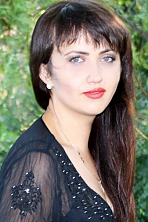 Ukrainian girl Tatiana,28 years old with grey eyes and dark brown hair.