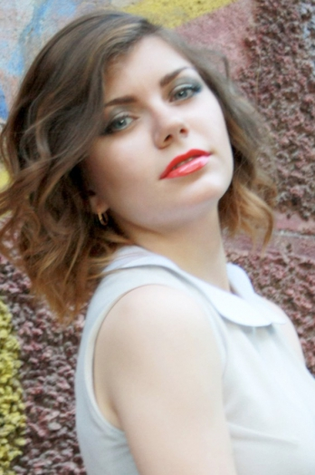 Ukrainian girl Maria,23 years old with blue eyes and light brown hair.
