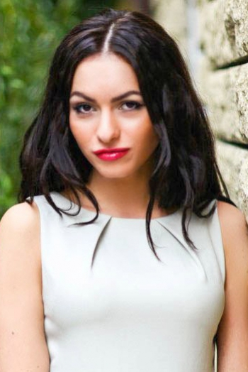 Ukrainian girl Anna,28 years old with brown eyes and black hair.