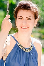 Ukrainian girl Marina,31 years old with hazel eyes and dark brown hair.