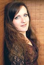 Ukrainian girl Marina,34 years old with green eyes and dark brown hair.