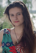 Ukrainian girl  Diana,20 years old with brown eyes and dark brown hair.