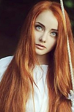 Ukrainian girl Jennia,28 years old with blue eyes and red hair.