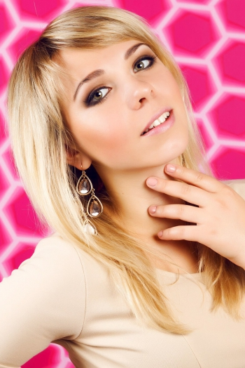 Ukrainian girl Yana,23 years old with green eyes and blonde hair.