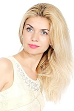 Ukrainian girl Larisa,41 years old with green eyes and blonde hair.
