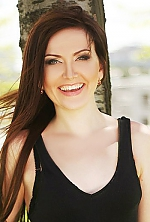Ukrainian girl Kristina,28 years old with green eyes and auburn hair.