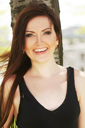 Ukrainian girl Kristina,28 years old with green eyes and auburn hair.