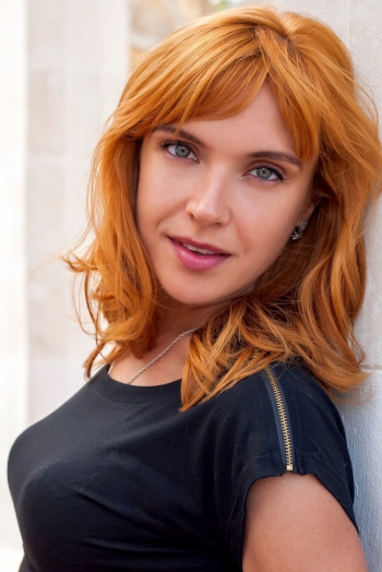 Ukrainian girl Olga,30 years old with green eyes and red hair.