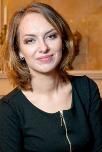 Ukrainian girl Anastasiya,25 years old with hazel eyes and light brown hair.