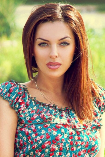 Ukrainian girl Marina,25 years old with blue eyes and light brown hair.