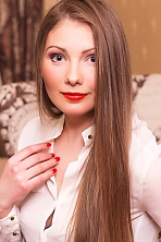 Ukrainian girl Svitlana,34 years old with grey eyes and light brown hair.