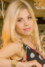 Ukrainian girl Olga ,24 years old with green eyes and blonde hair.