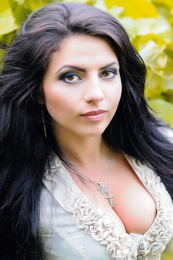 Ukrainian girl Zoryana ,21 years old with brown eyes and black hair.