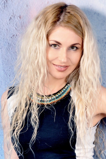 Ukrainian girl Eugenia,33 years old with green eyes and blonde hair.