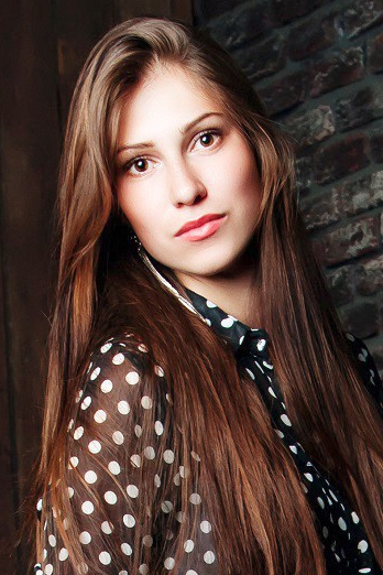 Ukrainian girl Masha,21 years old with brown eyes and light brown hair.